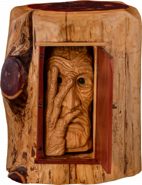 Wooden face carving within an open door sculpture
