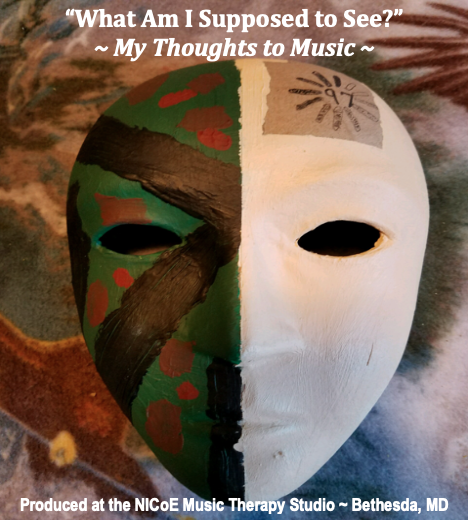 "Mask wth artwork on each side of the face, album artwork for ""What Am I Supposed to See?"""